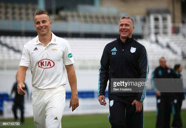 Tom Curran of Surrey and Surrey Director of Cricket Alec Stewart share a joke during the Surrey CCC Photocall at The Kia Oval on April 4, 2017 in...