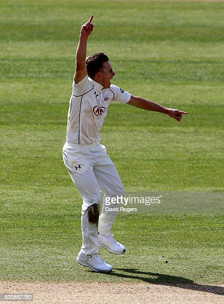 Tom Curran of Surrey celebrates after taking the wicket of Brendan Taylor during the Specsavers County Championship division one match between...