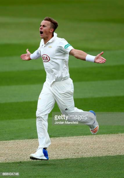 Tom Curran of Surrey celebrates bowling out Luke Procter of Lancashire during day one of the Specsavers County Championship Division One match...