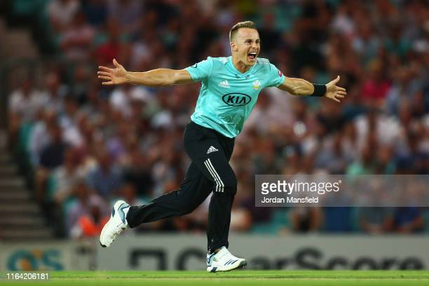 Tom Curran of Surrey celebrates dismissing Billy Root of Glamorgan during the Vitality Blast match between Surrey and Glamorgan at The Kia Oval on...