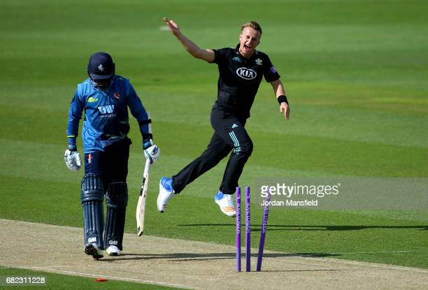 Tom Curran of Surrey celebrates dismissing Daniel BellDrummond of Kent during the Royal London OneDay Cup match between Surrey and Kent at The Kia...