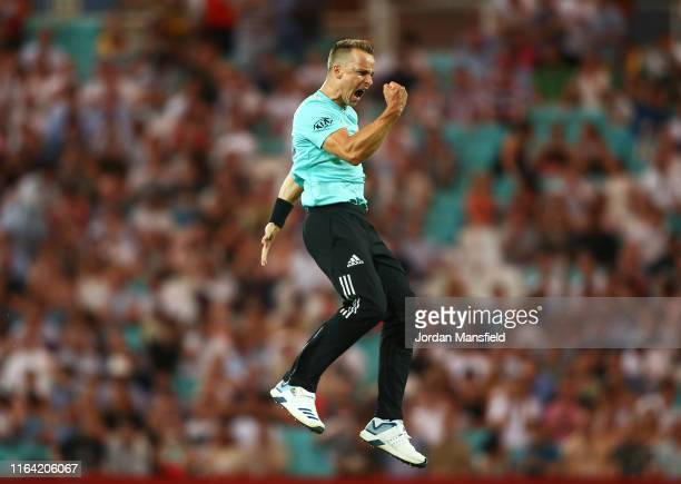 Tom Curran of Surrey celebrates dismissing David Lloyd of Glamorgan during the Vitality Blast match between Surrey and Glamorgan at The Kia Oval on...