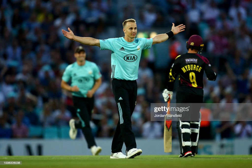 Tom Curran of Surrey celebrates dismissing Steve Davis of Somerset during the Vitality Blast match between Surrey and Somerset at The Kia Oval on July 27, 2018 in London, England.