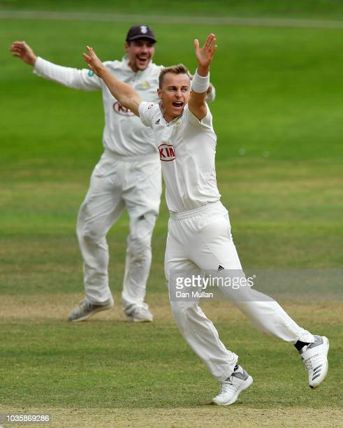 Tom Curran of Surrey celebrates taking the wicket of James Hildreth of Somerset during day two of the Specsavers County Championship Division One...