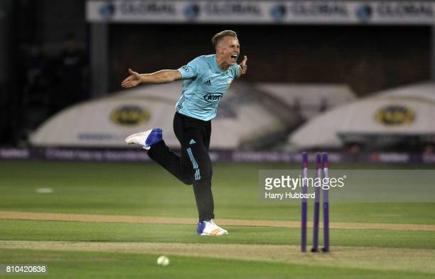 Tom Curran of Surrey celebrates the wicket of Ashar Zaidi of Essex during the Natwest T20 Blast match between Essex and Surrey at Cloudfm County...