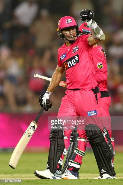 Tom Curran of the Sixers and Josh Philippe celebrate victory during the Big Bash League match between the Sydney Sixers and the Adelaide Strikers at...
