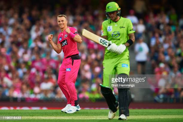Tom Curran of the Sixers celebrates after taking the wicket of Alex Hales of the Thunder during the Big Bash League match between the Sydney Sixers...