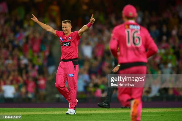 Tom Curran of the Sixers celebrates victory in the super over during the Big Bash League match between the Sydney Sixers and the Sydney Thunder at...