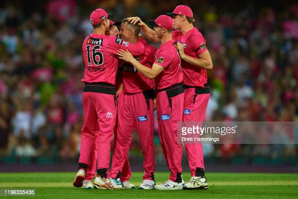 Tom Curran of the Sixers celebrates victory with team mates in the super over during the Big Bash League match between the Sydney Sixers and the...