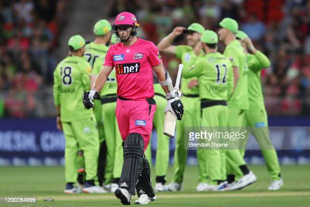 Tom Curran of the Sixers walks from the field after being run out by Nathan McAndrew of the Thunder during the Big Bash League match between the...