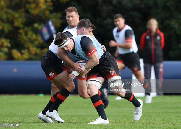 Tom Curry is tackled by George Ford during the England training session held at Pennyhill Park on November 9 2017 in Bagshot England