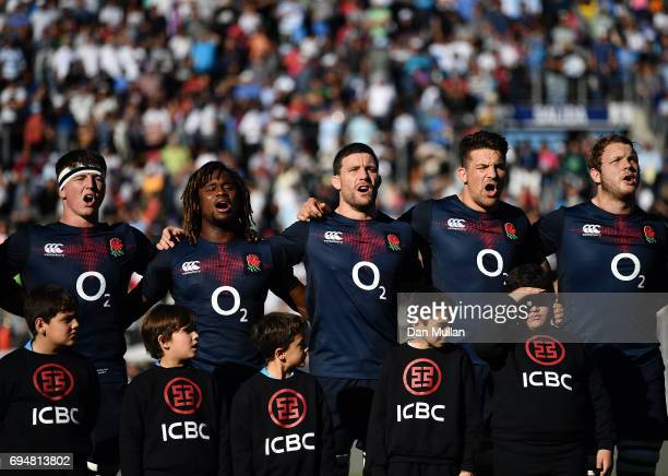 Tom Curry Marland Yarde Mark Wilson Charlie Ewels and Joe Launchbury of England sing the national anthem prior to the ICBC Cup match between...