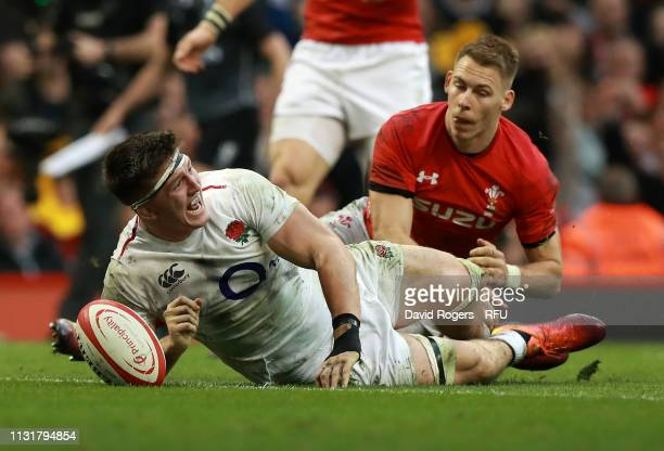 Tom Curry of England celebrates scoring a try during the Guinness Six Nations match between Wales and England at the Principality Stadium on February...