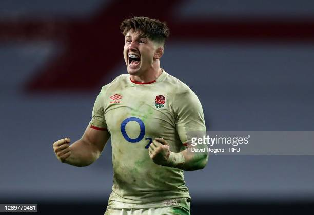 Tom Curry of England celebrates winning a penalty which wins the game after a successful kick from team mate Owen Farrell during the Autumn Nations...