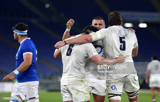 Tom Curry of England celebrates with Henry Slade of England and Jonny Hill of England after scoring his sides fourth try during the 2020 Guinness Six...