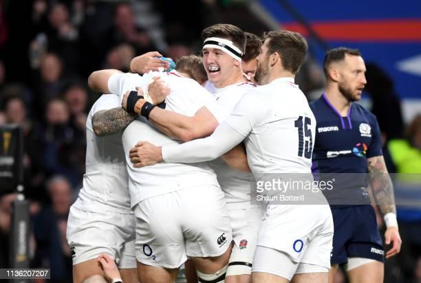 Tom Curry of England celebrates with team mates after scoring his team's second try during the Guinness Six Nations match between England and...