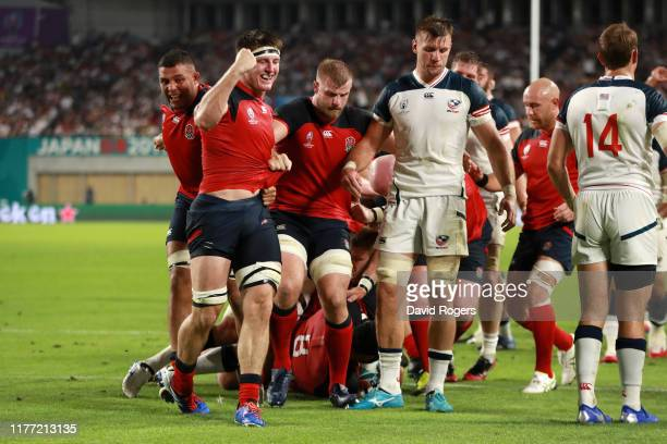 Tom Curry of England celebrates with teammate Lewis Ludlam after their team's second try during the Rugby World Cup 2019 Group C game between England...