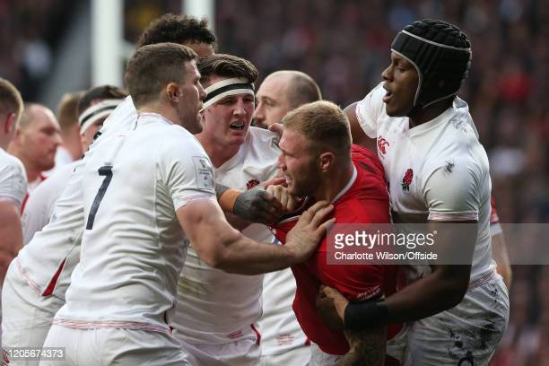 Tom Curry of England fights with Ross Moriarty of Wales during the 2020 Guinness Six Nations match between England and Wales at Twickenham Stadium on...
