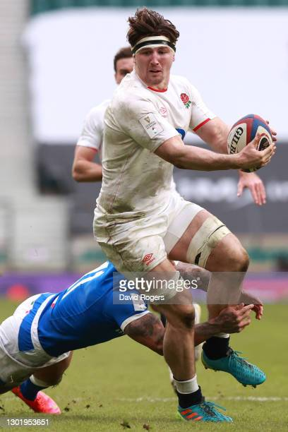 Tom Curry of England goes past Monty Ioane of Italy during the Guinness Six Nations match between England and Italy at Twickenham Stadium on February...