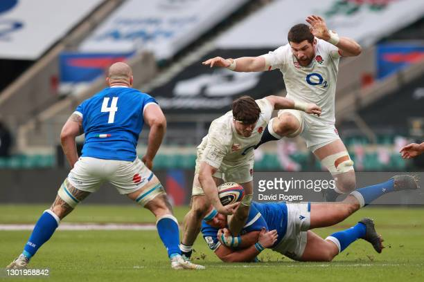 Tom Curry of England is held by Andrea Lovotti of Italy during the Guinness Six Nations match between England and Italy at Twickenham Stadium on...