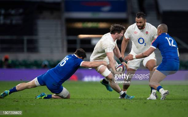 Tom Curry of England is tackled by Camille Chat of France during the Guinness Six Nations match between England and France at Twickenham Stadium on...