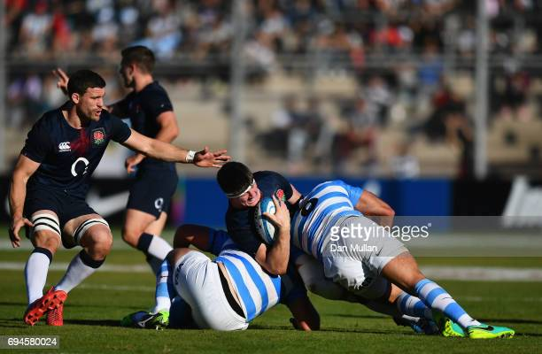 Tom Curry of England is tackled by Enrique Pieretto and Juan Manuel Leguizamon of Argentina during the International Test match between Argentina and...