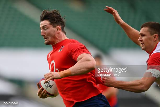 Tom Curry of England makes a break under pressure from Henry Slade of England during a training session at Twickenham Stadium on February 20, 2021 in...
