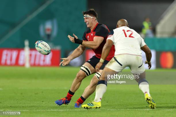 Tom Curry of England offloads the ball under pressure from Paul Lasike of USA during the Rugby World Cup 2019 Group C game between England and USA at...