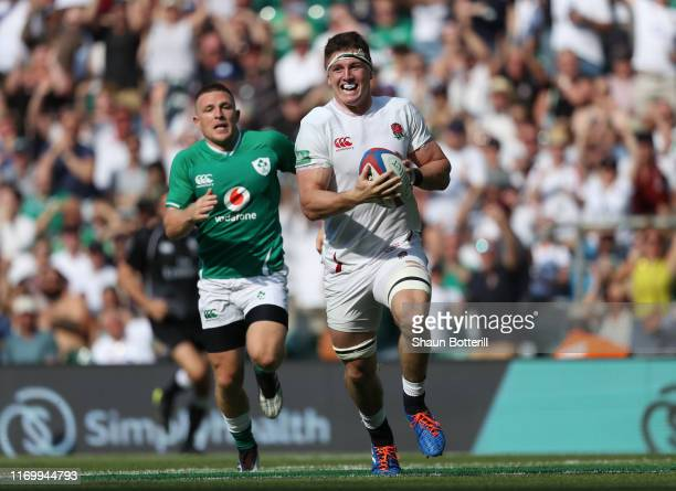 Tom Curry of England scores a try during the Quilter International match between England and Ireland at Twickenham Stadium on August 24 2019 in...