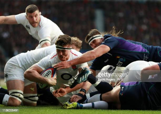 Tom Curry of England scores his team's second try during the Guinness Six Nations match between England and Scotland at Twickenham Stadium on March...