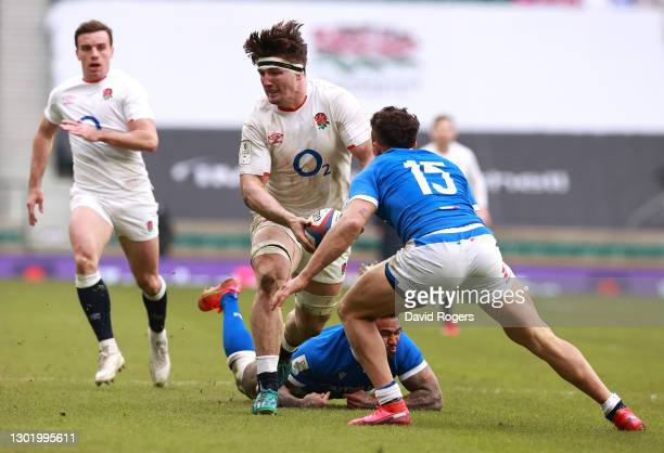 Tom Curry of England takes on Jacopo Trulla of Italy attempts to catch the ball during the Guinness Six Nations match between England and Italy at...