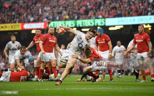 Tom Curry of England touches down for the first try during the Guinness Six Nations match between Wales and England at Principality Stadium on...