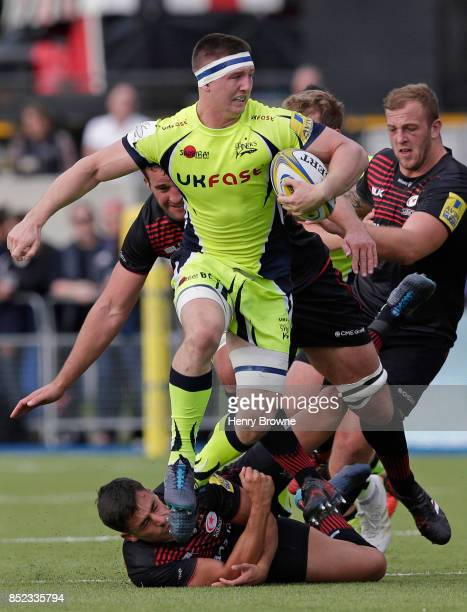 Tom Curry of Sale Sharks and Alex Lozowski of Saracens during the Aviva Premiership match between Saracens and Sale Sharks at Allianz Park on...