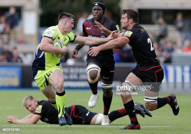 Tom Curry of Sale Sharks hands off Calum Clark of Saracens during the Aviva Premiership match between Saracens and Sale Sharks at Allianz Park on...