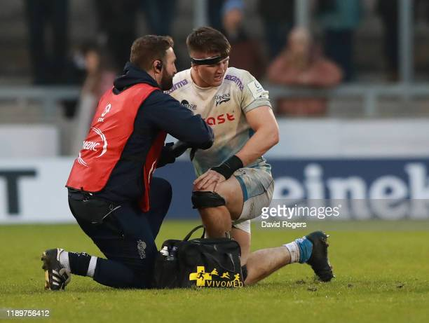 Tom Curry of Sale Sharks receives attention during the Heineken Champions Cup Round 2 match between Sale Sharks and La Rochelle at AJ Bell Stadium on...