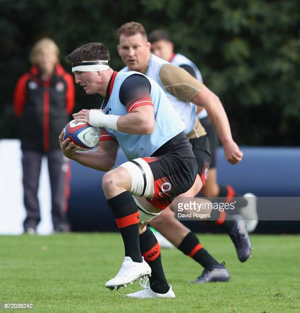 Tom Curry runs with the ball during the England training session held at Pennyhill Park on November 9 2017 in Bagshot England