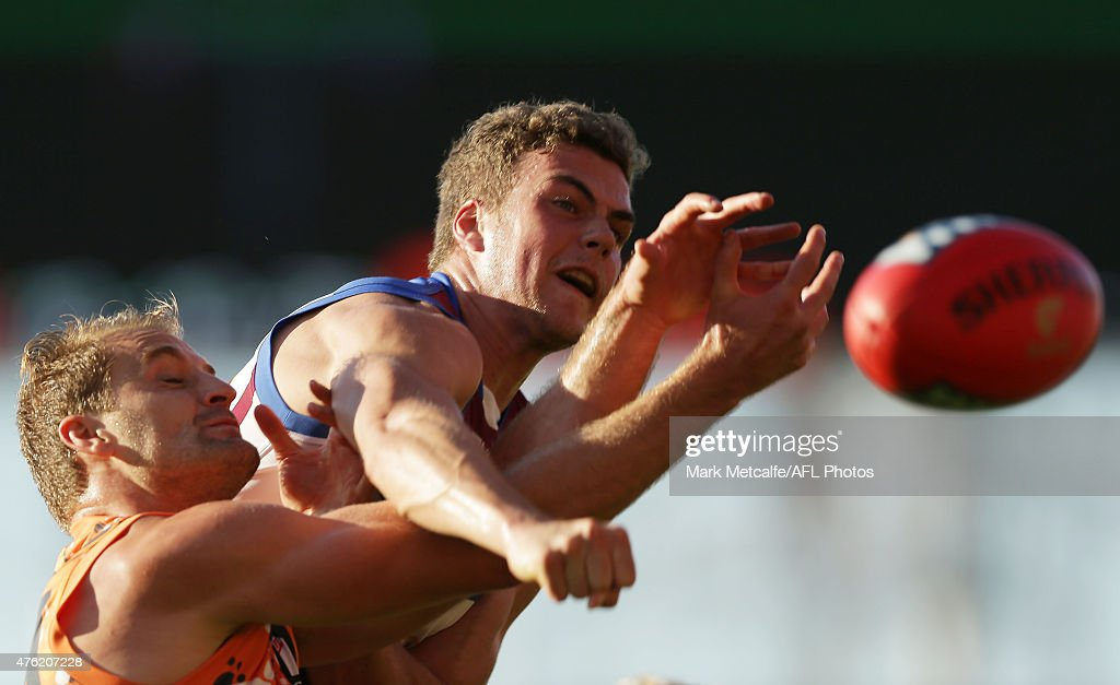 Tom Cutler of the Lions and Joel Patfull of the Giants compete for the ball during the round 10 AFL match between the Greater Western Sydney Giants and the Brisbane Lions at Spotless Stadium on June 7, 2015 in Sydney, Australia.