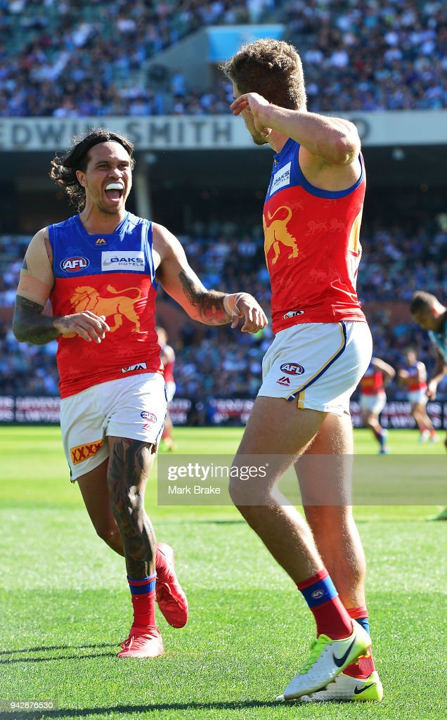 Tom Cutler of the Lions celebrates a goal with Allen Christensen of the Lions during the round three AFL match between the Port Adelaide Power and the Brisbane Lions at Adelaide Oval on April 7, 2018 in Adelaide, Australia.