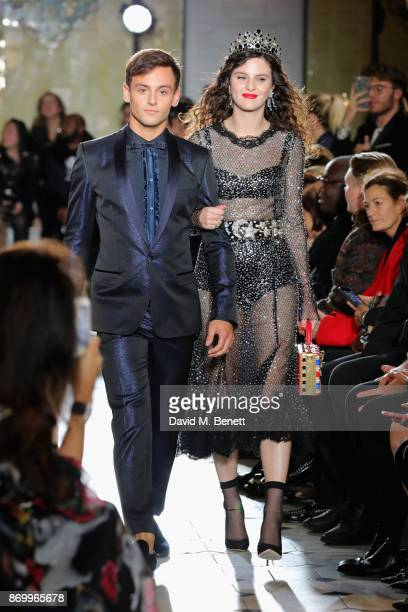 Tom Daley and Daisy Maybe walk the Dolce Gabbana Italian Christmas catwalk show at Harrods on November 2 2017 in London England