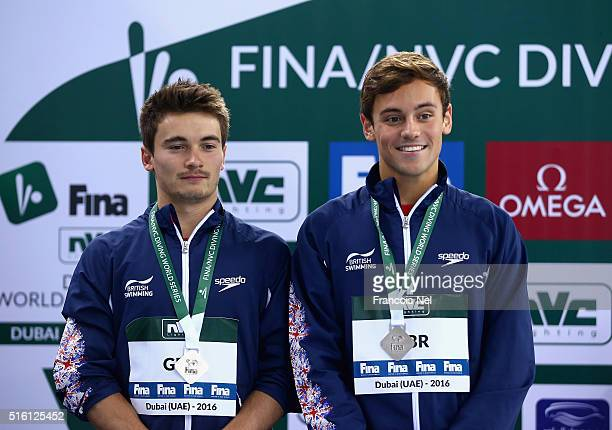 Tom Daley and Daniel Goodfellow of Great Britain pose with their Silver medals after the Men's 10m Synchro Platform Final during day one of the...