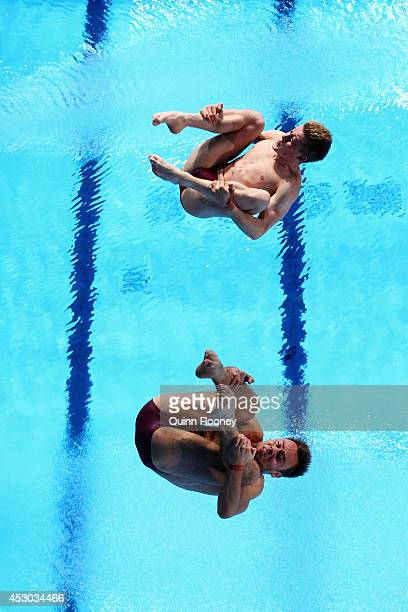 Tom Daley and Denny James of England compete in the Men's Synchronised 10m Platform Final at Royal Commonwealth Pool during day nine of the Glasgow...