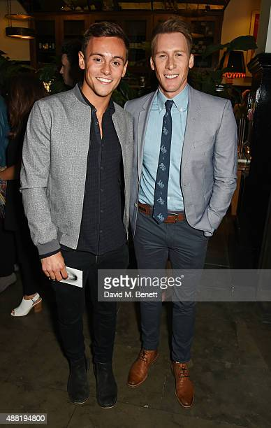 Tom Daley and Dustin Lance Black attend the 'Photograph 51' press night after party at the The National Cafe on September 14 2015 in London England