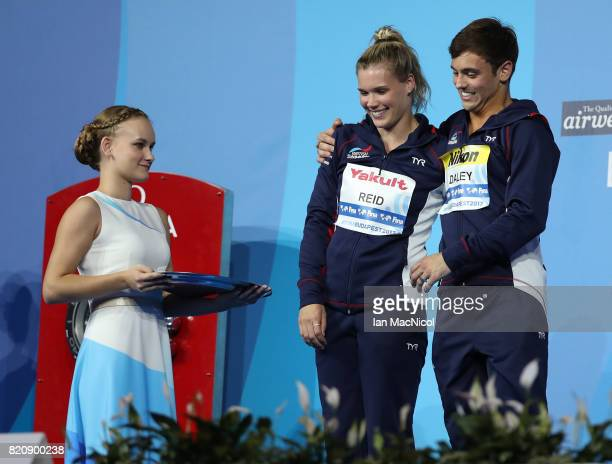 Tom Daley and Grace Reid of Great Britain are presented with their silver medals from the Mixed 3m Synchro Springboard during day nine of the FINA...