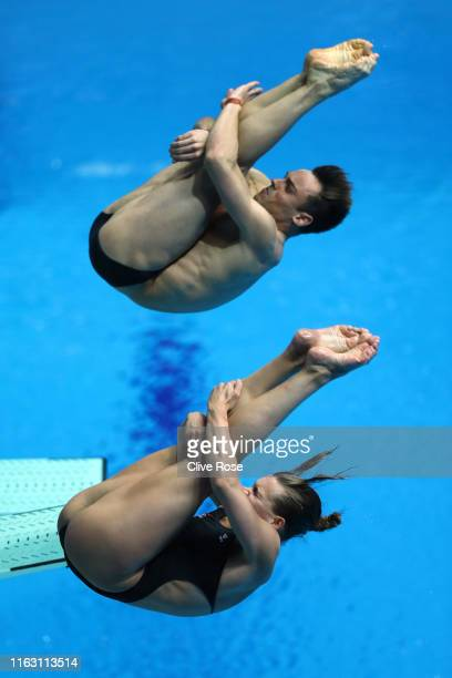 Tom Daley and Grace Reid of Great Britain compete in the Mixed 3m Synchro Springboard Final during day nine of the Gwangju 2019 FINA World...