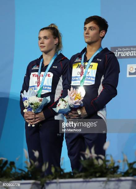 Tom Daley and Grace Reid of Great Britain pose with their silver medals from the Mixed 3m Synchro Springboard during day nine of the FINA World...