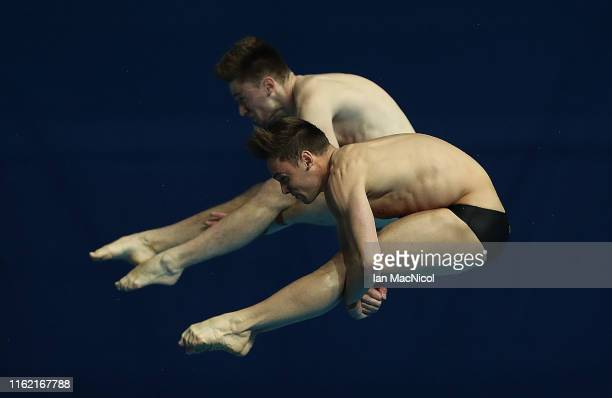 Tom Daley and Matthew Lee of Great Britain compete in the final of the Men's 10m Synchro Platform diving during day four of the Gwangju 2019 FINA...