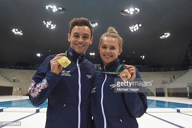 Tom Daley and Tonia Couch of Great Britain celebrate with their gold and bronze medals after the Men's and Women's 10m Finals during the FINA/NVC...