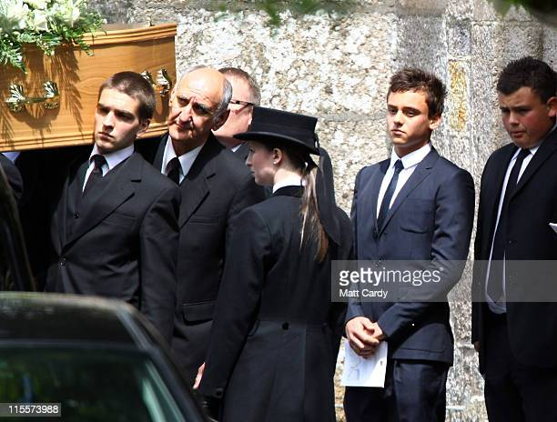 Tom Daley follows the coffin carrying his father Robert Daley as it leaves St Mary's Church on June 8 2011 in Plympton England British diving...