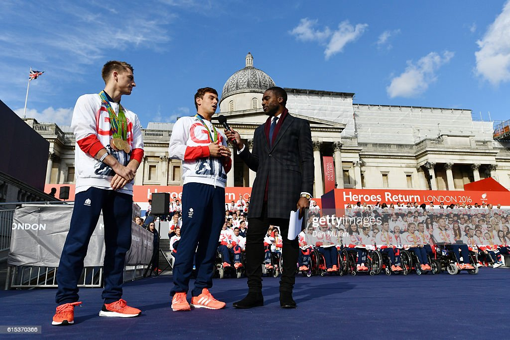 Tom Daley is interviewed by Ore Oduba during the Olympics & Paralympics Team GB - Rio 2016 Victory Parade at Trafalgar Square on October 18, 2016 in London, England.