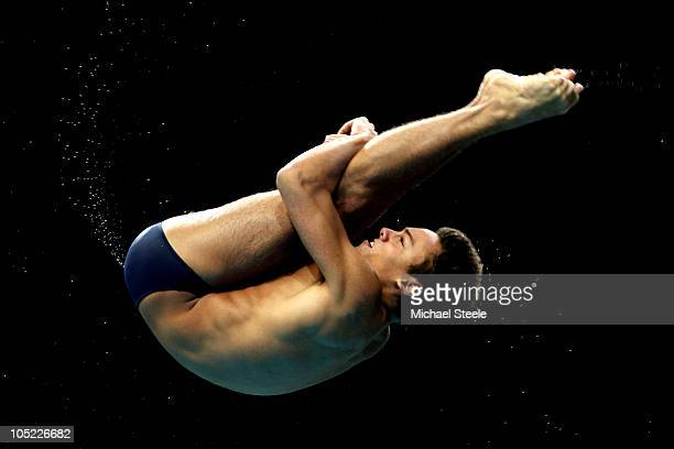 Tom Daley of England competes in the Men's 10m Platform Preliminary at the Dr SP Mukherjee Aquatics Complex during day ten of the Delhi 2010...